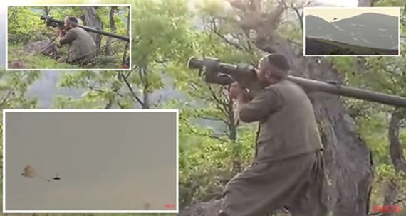 Dramatic moment Kurdish fighters down helicopter with missile