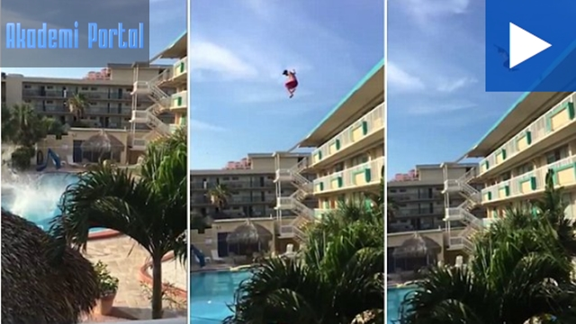 Fearless daredevil hurtles from top of apartment into pool