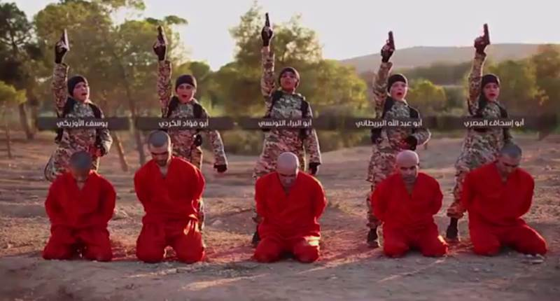 Sickening footage shows: The white British ISIS child executioner