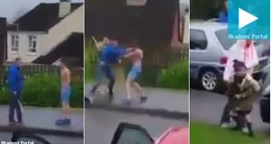 Thugs brawl with hurling sticks as parents collect children - Video