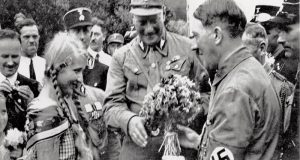 The smiling face of evil: Adolf Hitler