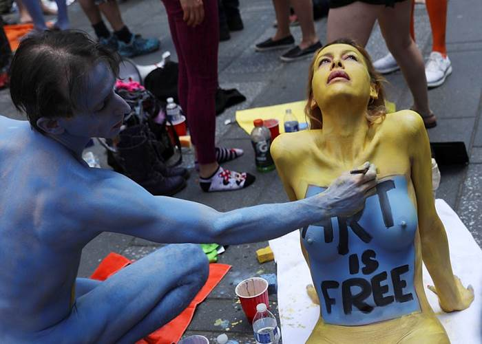 Hundreds of models pose NAKED in Times Square to 'promote positivity and acceptance'