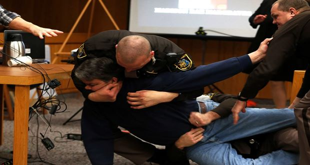 Father of three girls molested by Nassar tries to attack doctor